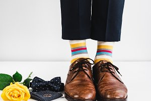 Wedding rings, rose and funny socks