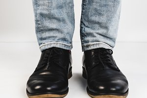 Male legs in black shoes