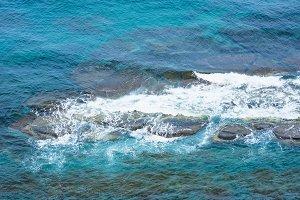 Sea water, foam on the rocks