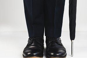 Stylish shoes, umbrella and men's legs