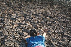 girl tired on cracked ground