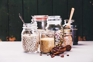 Glass jars with various legumes and grains