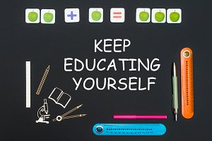 Above stationery supplies and text keep educating yourself on blackboard