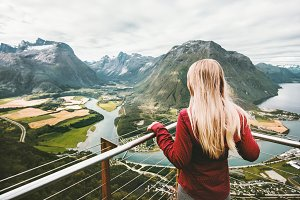 Blonde woman enjoying mountains