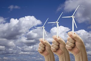 Male Fists Hold Three Wind Turbines
