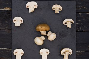 Cut champignons on a stone tray.