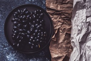 Dark grapes on a plate