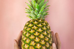 Female hand with pineapple