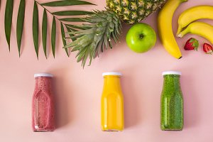Colorful smoothies in bottles
