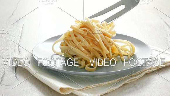 Putting Spaghetti For Cooking With Tongs Cooking Spaghetti Concept Female Hand Putting Spaghetti In Plate