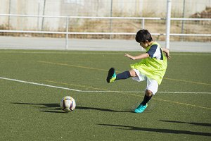 Young football player in a training