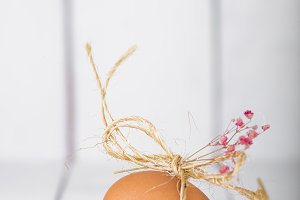 Easter egg on a white wooden background