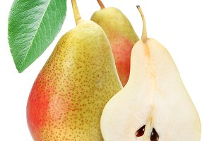 Two appetizing pears with a leaf. Isolated on a white background.