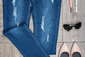 Aerial view of woman's jeans and accessories