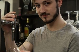 waiter serving beer in the pub