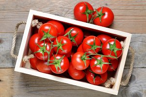 Tomatoes in wooden box top view
