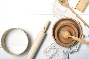 round plates, sieve and rolling pin