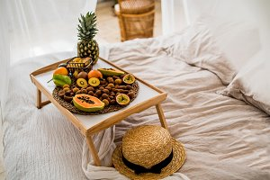 tropical fruits on the tray on the b