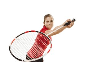 Young woman playing badminton over white background