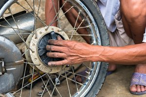 mechanic changing motorcycle
