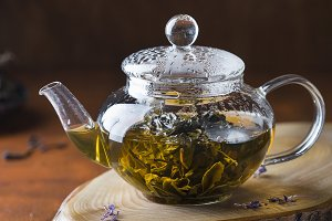 green tea in a glass teapot