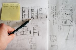 Architect drawing sketches by pencil