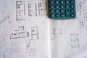 Architect sketches on paper