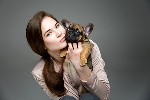 girl with french bulldog puppy