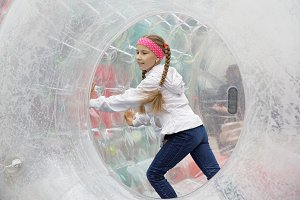 Children's entertainment in the amusement park-running inside the zorb