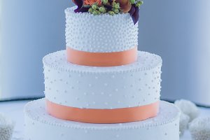 White and Orange Tiered Wedding Cake