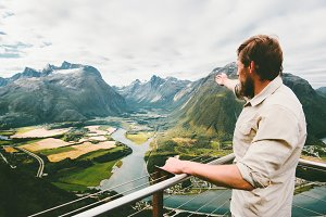 Man traveler enjoying mountains