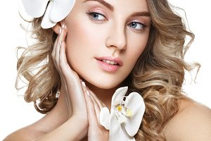 beautiful blond girl with flower