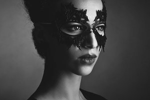 girl with horns hairstyle in leather mask