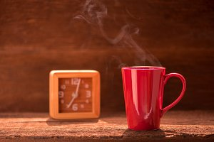 red coffee cup with smoke stream