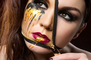 beautiful young woman with zipper on face
