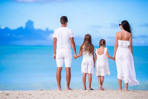 Rear view of beautiful family on the beach