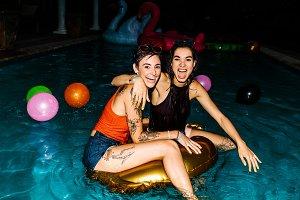 Female friends enjoying evening pool
