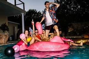 Friends partying in a pool