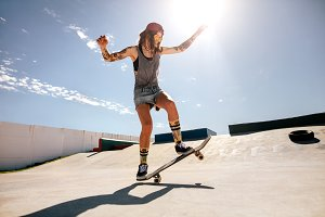 Female skater skateboarding at skate