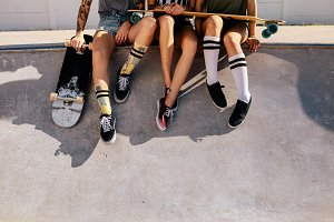 Legs of women sitting on ramp