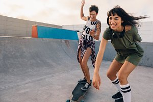 Girls riding on skateboards