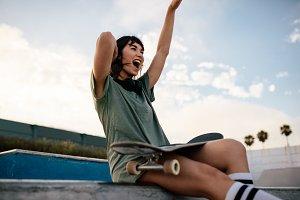 Female skateboarder enjoying herself