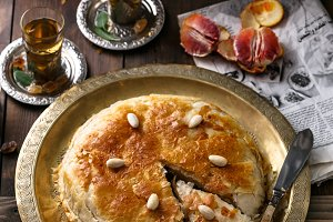 Middle eastern pie with tea, traditional style
