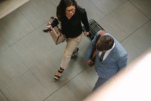 Business travelers walking together
