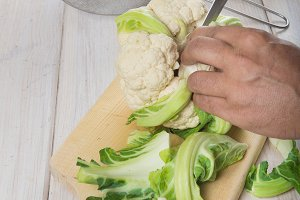 Chef preparing and cleaning a cauliflower