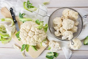Raw cauliflower on the table of the kitchen