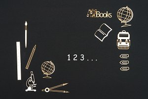 School supplies placed on black background with numbers 123