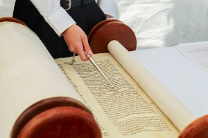 Hand of boy reading the Jewish Torah
