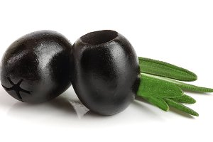 whole black olives with rosemary leaf isolated on white background macro