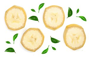 Banana slices decorated with green leaves isolated on a white background. Flat lay, top view